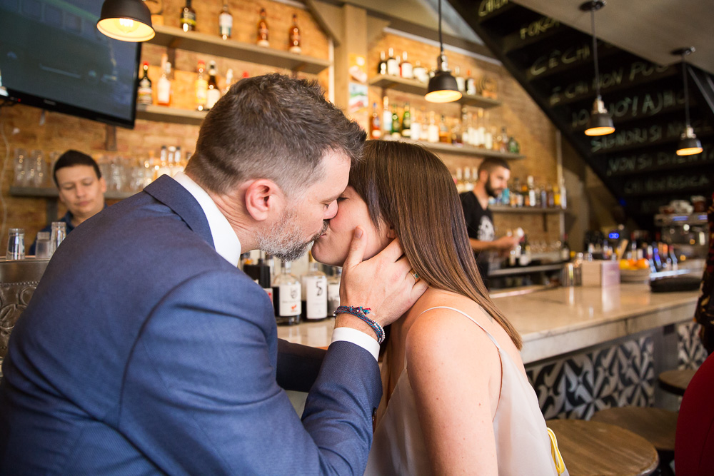 The wedding couple at the bar at Lupo Verde, Washington DC | Candid Wedding Photographer