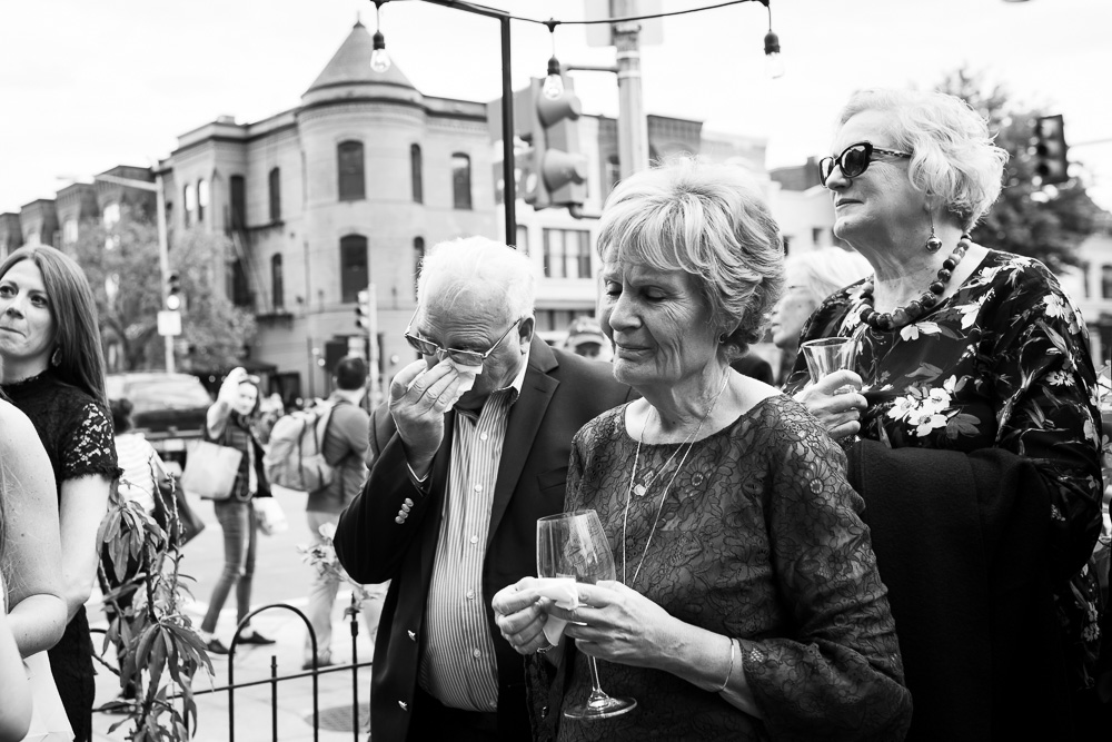 Emotional parents watching the surprise wedding | Documentary and Candid Wedding Photography in DC