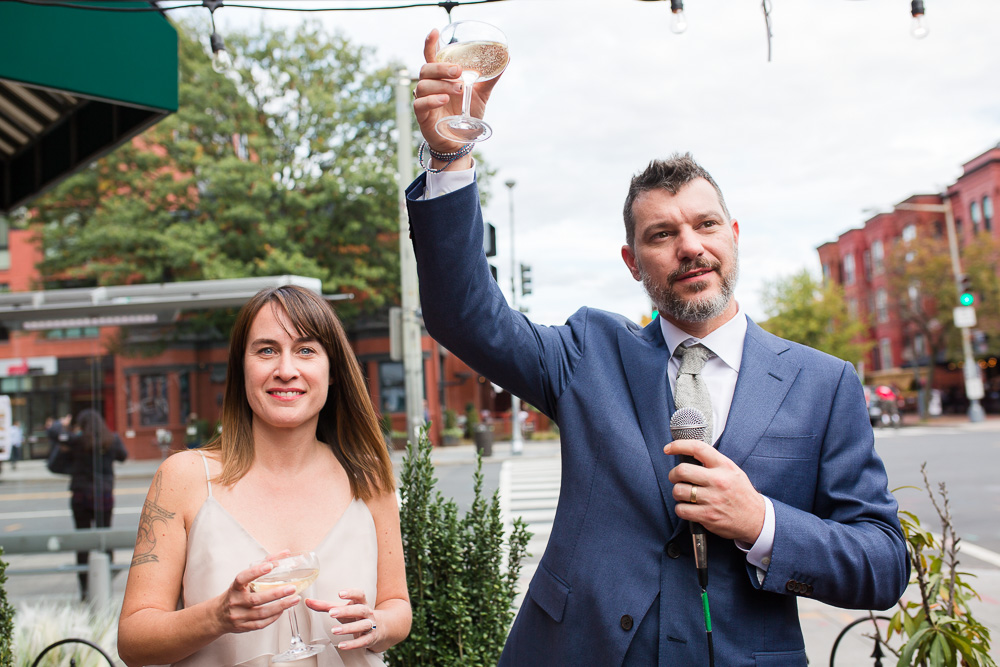 Bride and groom toasts on 14th Street