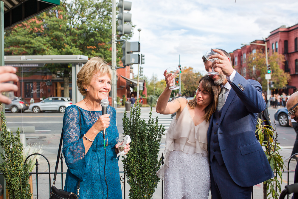 Raising a glass during the toasts | Unique DC Wedding Venue | Outdoor Ceremony