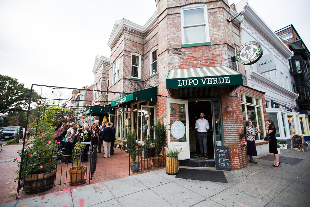 Photo of Lupo Verde with wedding guests on the outdoor patio