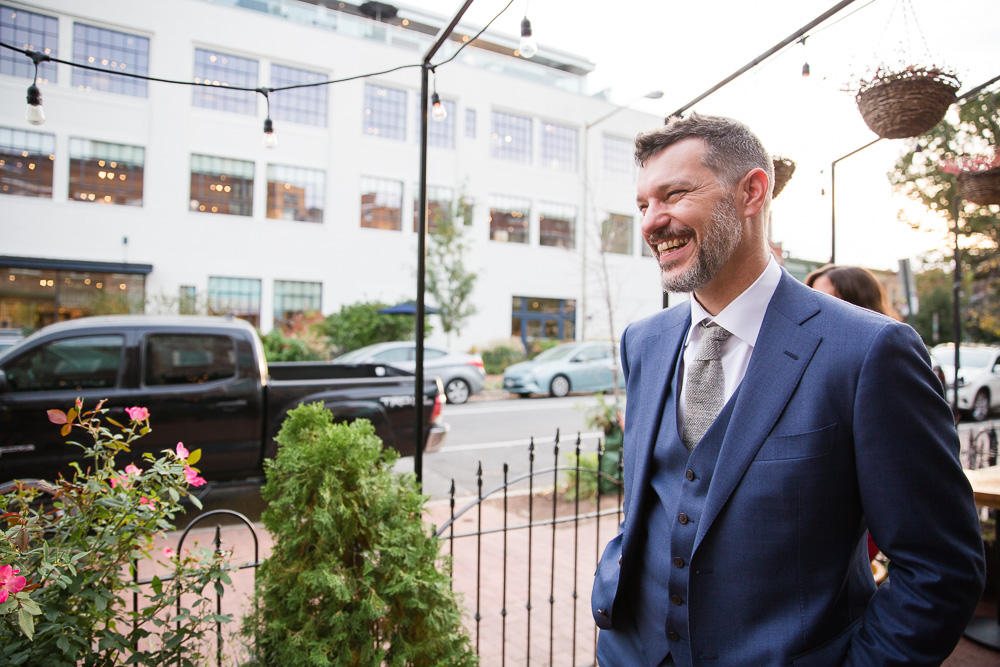 Smiling groom at his alternative DC wedding