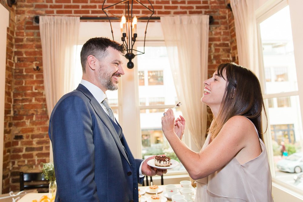 Bride and groom sharing cake during their wedding reception | Fun Wedding Photography in Washington DC