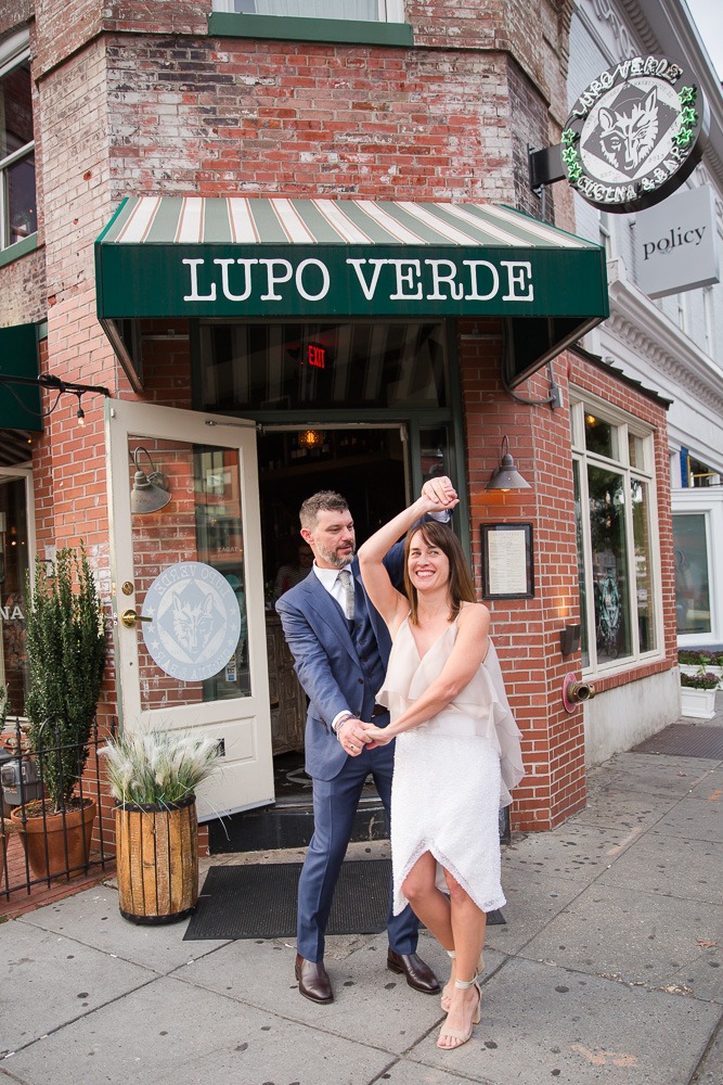 Wedding couple dancing in front of their wedding venue | Lupo Verde Wedding in Washington DC