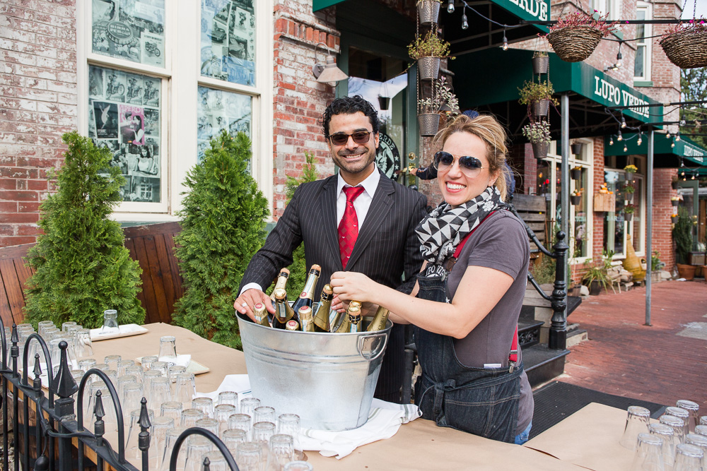 Staff preparing the Prosecco for wedding toasts