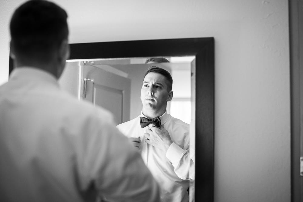 Groom straightening his tie | Documentary Rochester NY Wedding Photography