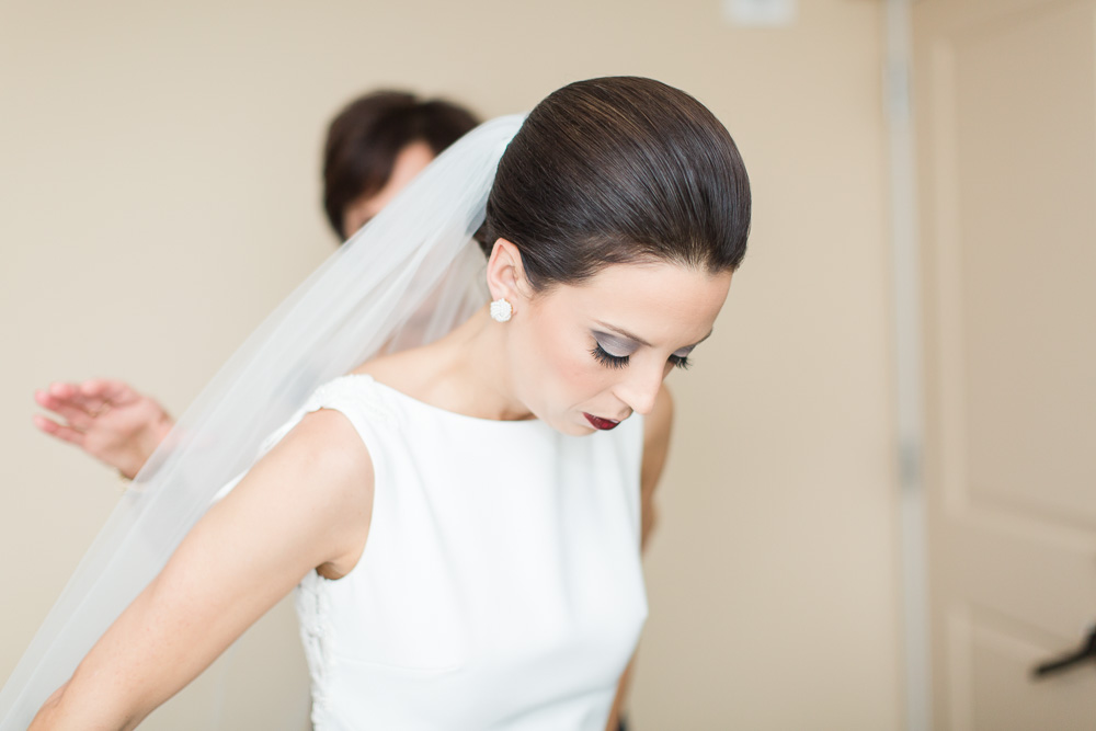 Bride putting on her wedding dress | Megan Rei Photography | Rochester NY Photographer