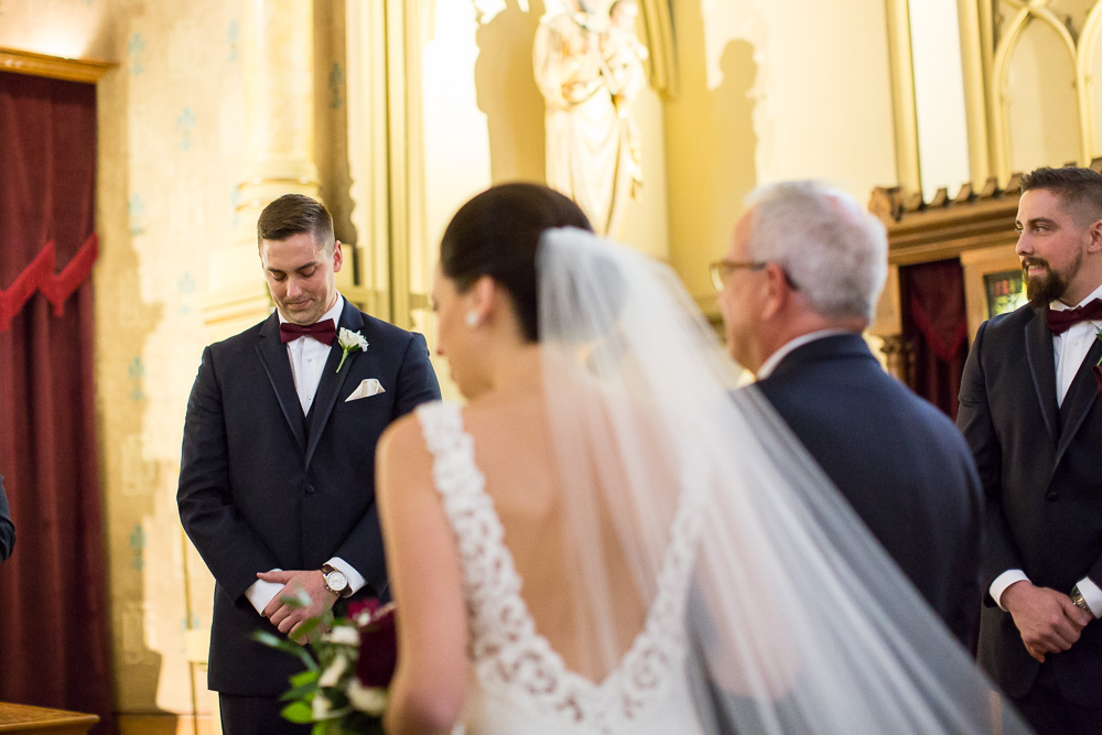 Groom's reaction as he watches the bride walk down the aisle | Candid Wedding Photography at Chapel Hill | Rochester New York Church Wedding