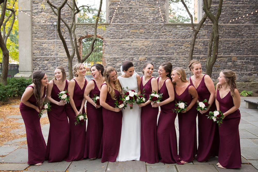 Candid bridal party photo in Rochester, NY | Wedding dress from Pronovias at Silk Bridal Boutique | Burgundy bridesmaid dresses from Vera Wang at David's Bridal