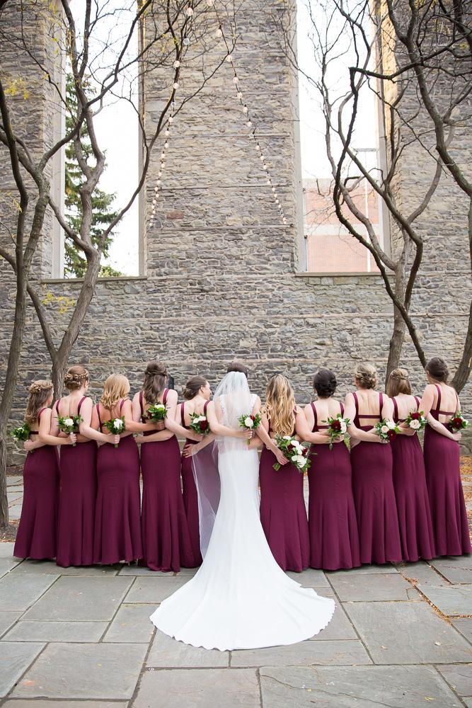 Bridal party photos at St. Joseph's Park | Wedding dress from Pronovias at Silk Bridal Boutique | Maroon bridesmaid dresses from Vera Wang at David's Bridal