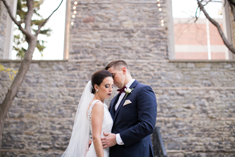 Romantic photo of bride and groom at St. Joseph's Park | Bella and Co Weddings and Events | Rochester, NY | Megan Rei Photography