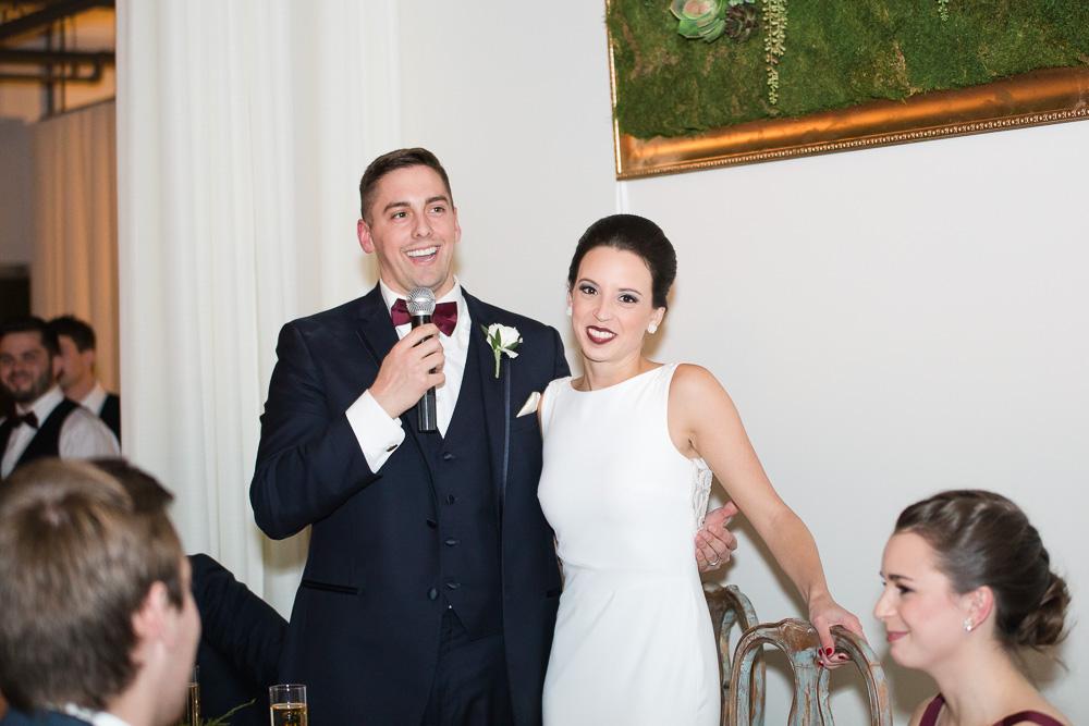 Wedding couple giving a speech at the reception