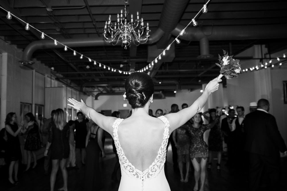 Bouquet toss at Arbor Loft | Documentary Wedding Photography