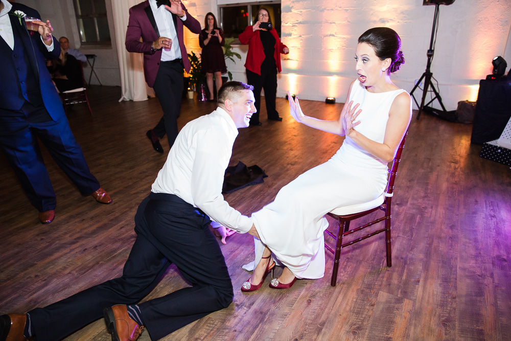 Funny garter removal at Rochester NY Wedding