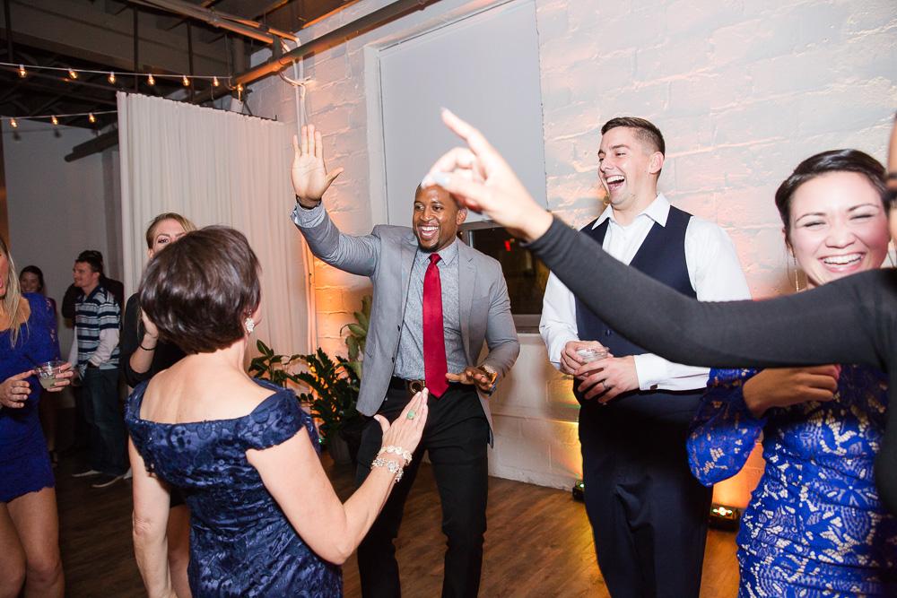 Having fun on the dance floor at Arbor Loft | DJ Hogan with Breakthrough Entertainment | Fun Wedding Venues in Rochester, NY
