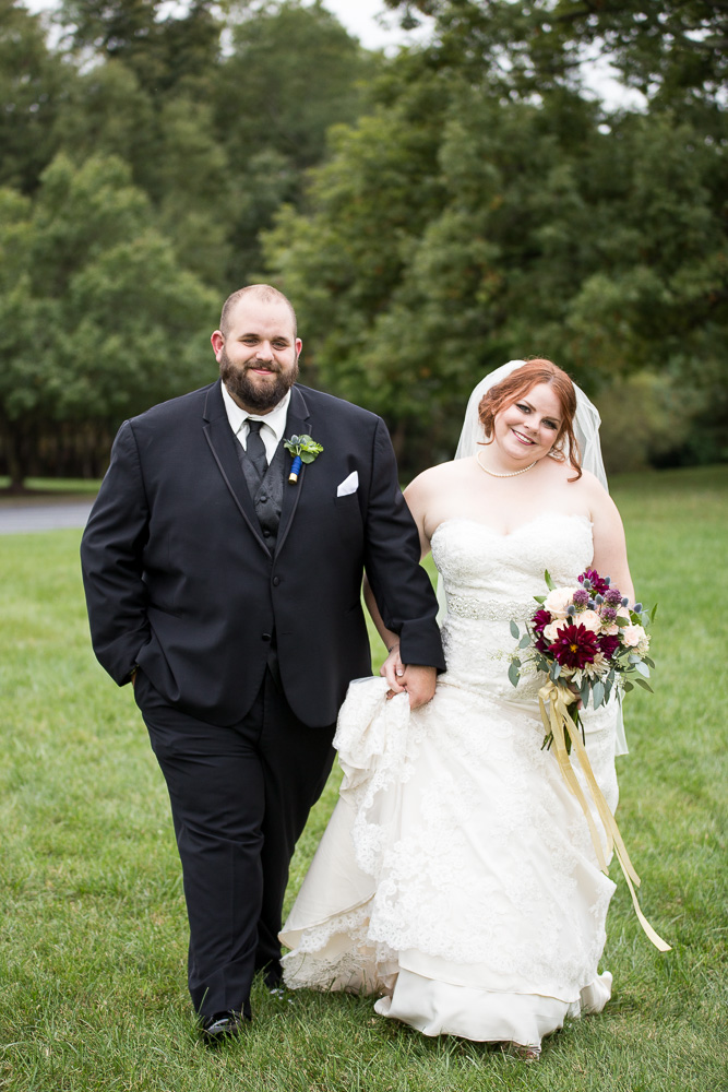 Candid photo of bride and groom walking at their wedding venue