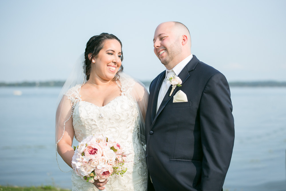Smiling wedding couple by the lake