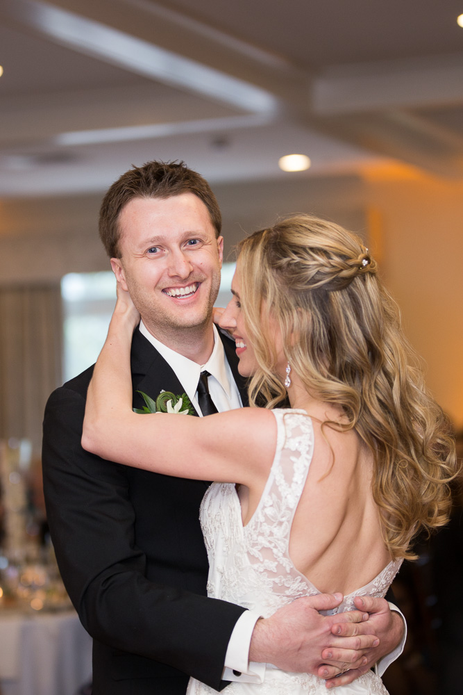 Candid dance floor photo of bride and groom