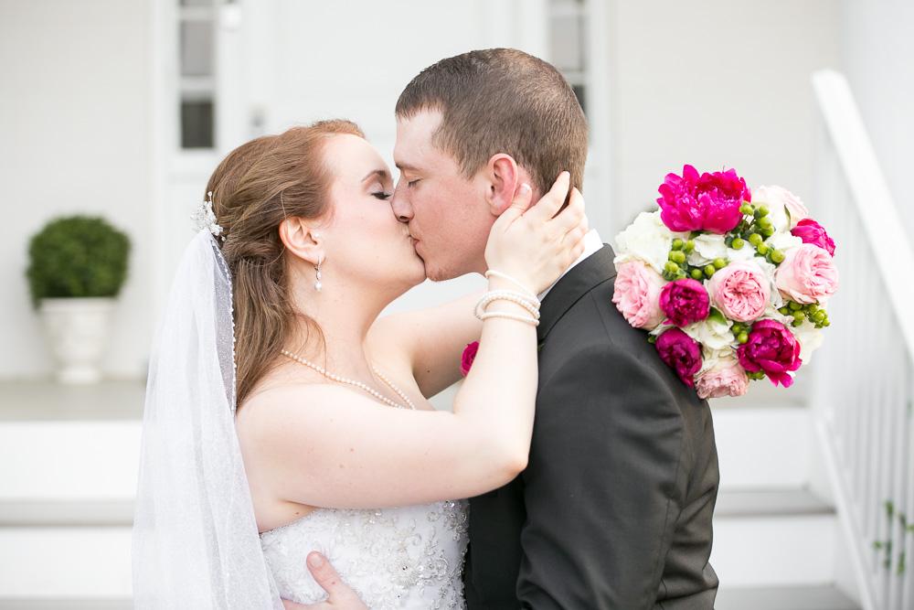 Bride and groom kiss at their wedding in Haymarket, Virginia