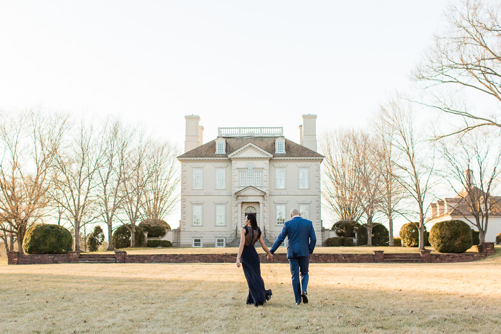 Bride and groom walking in the south courtyard of Great Marsh Estate | Northern Virginia Manor Wedding Venue