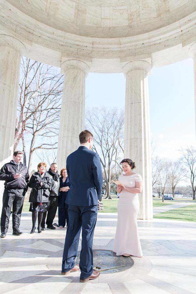 Reading vows during small wedding ceremony at the DC War Memorial | DC War Memorial Wedding Pictures