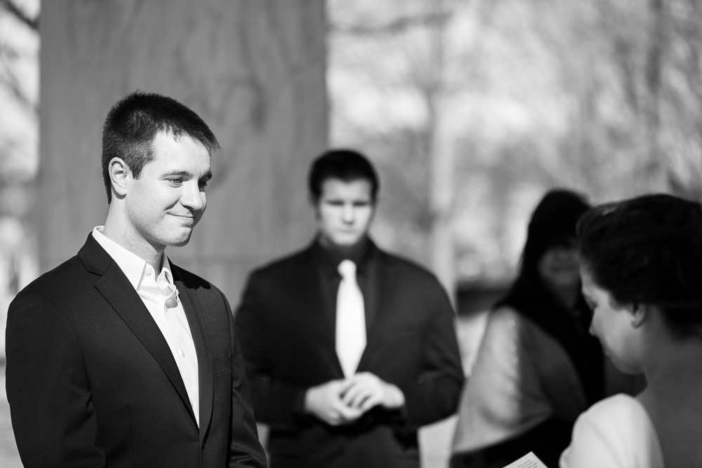 Candid photo of groom listening to wedding vows | Candid DC Wedding Photographer | Megan Rei Photography