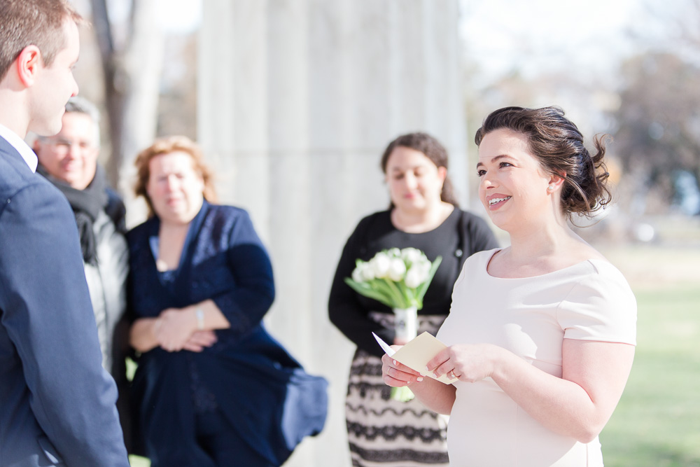Bride reading her personalized wedding vows at the DC War Memorial | DC Wedding Venues for Elopements and Small Weddings