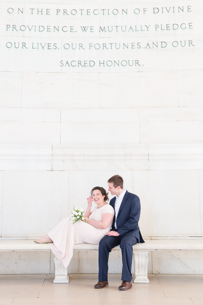 Laughing on the bench at the Jefferson Memorial | Candid Wedding Photography in Washington, DC | Megan Rei Photography