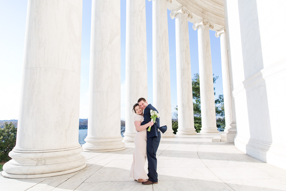 Smiling wedding couple at the Jefferson Memorial with beautiful blue skies | Fun Wedding Photographer in Washington, DC | Megan Rei Photography