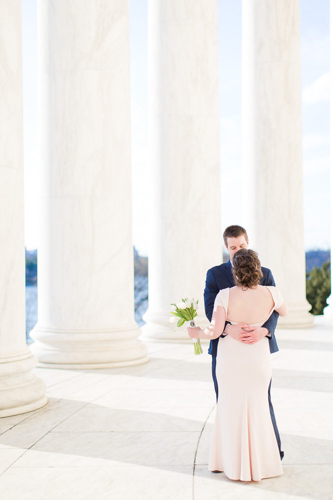 Classic DC wedding photo with the white marble columns of the monuments