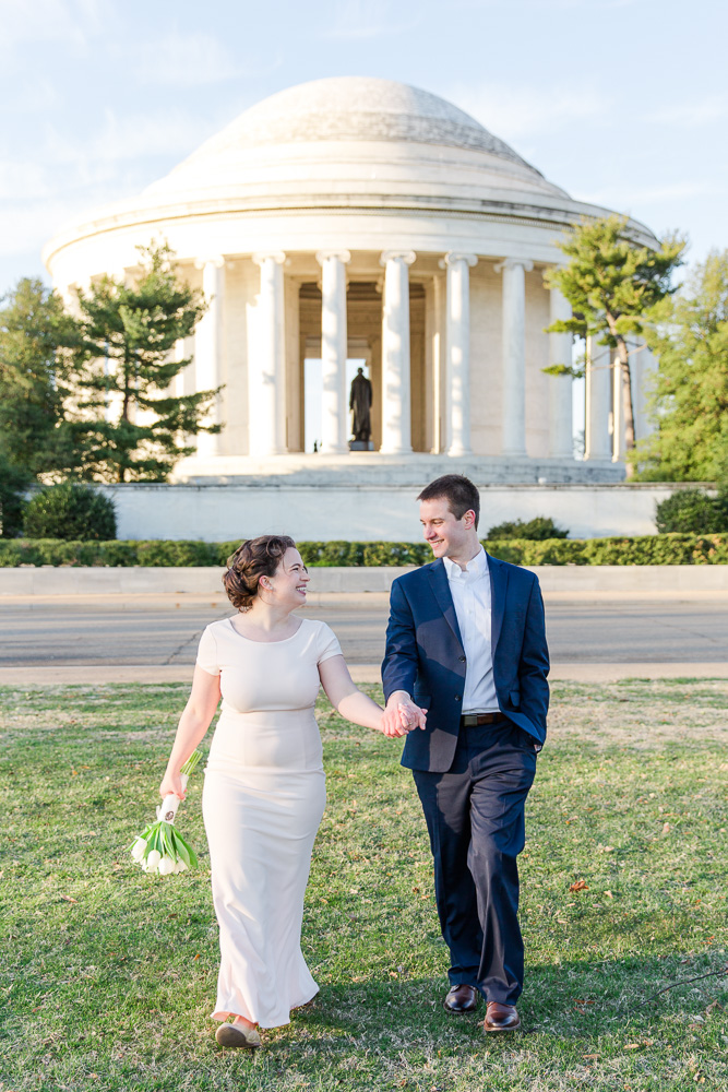 Walking on the lawn behind the Jefferson Memorial | DC Wedding Venues