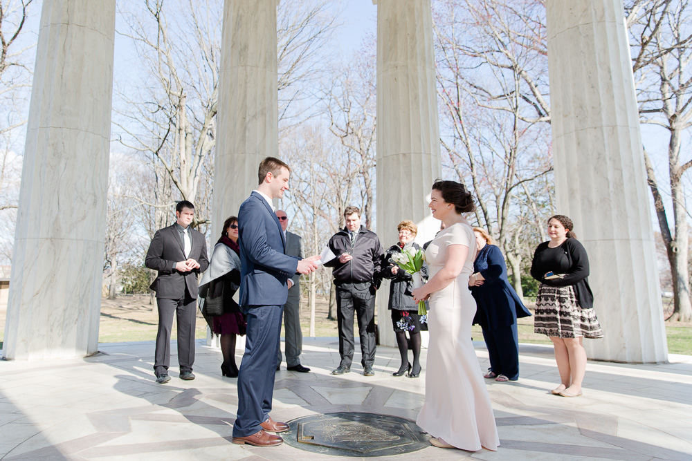 Reading vows during small wedding ceremony at the DC War Memorial | DC Monument Wedding Photos | Washington DC Elopement Photographer