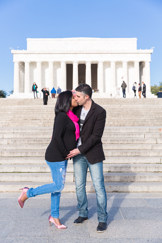 A kiss in front of the Lincoln Memorial | DC Maternity Photographer