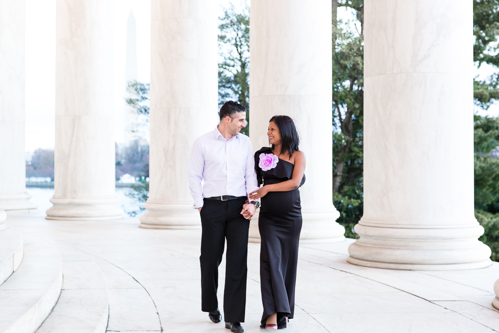 Walking through the columns at the Jefferson Memorial in Washington DC | Northern Virginia Maternity Photographer
