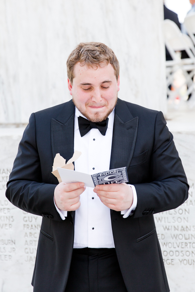 Emotional groom reading a letter from the bride | Washington DC Candid Wedding Photography