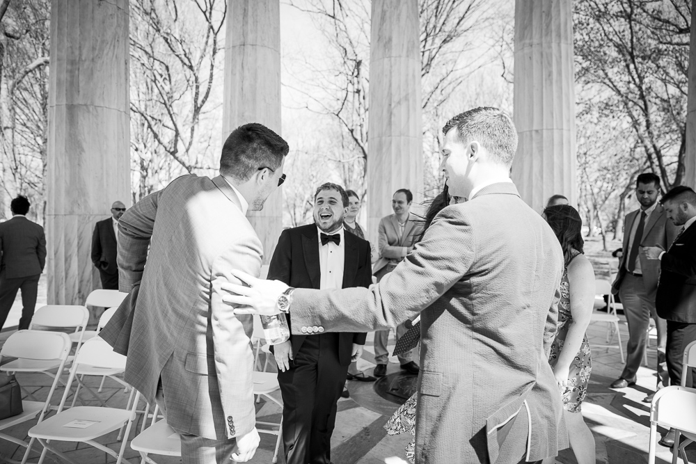 Candid moment captured of the groom and his friends | Candid wedding photographer in DC | DC War Memorial Wedding Photos