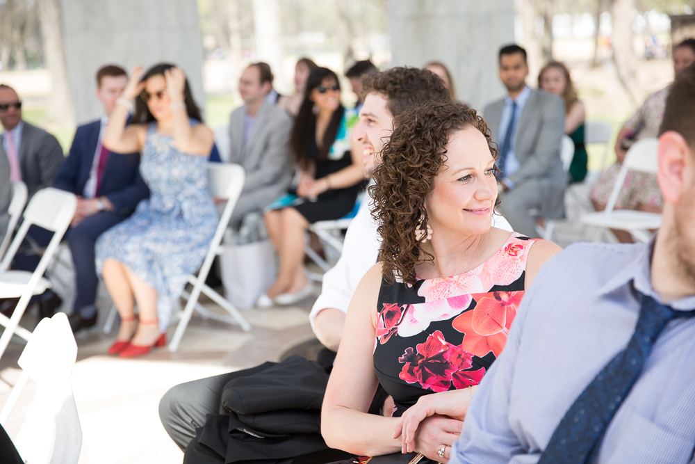 Guests watching the bride walk down the aisle | Candid DC Wedding Photography