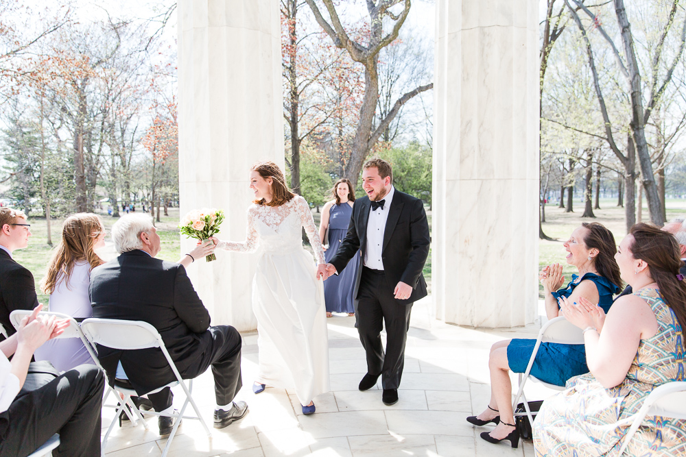 Just married and walking back up the aisle at the DC War Memorial | Best Outdoor Wedding Venues in Washington DC