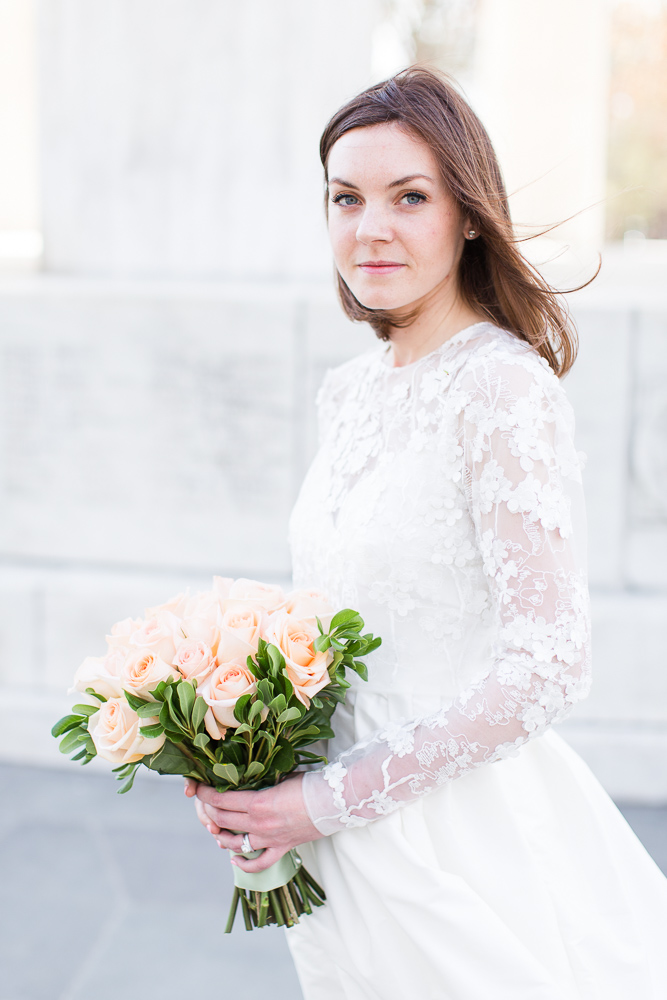 Bridal portrait at the DC War Memorial with floral bouquet from Allan Woods Flowers