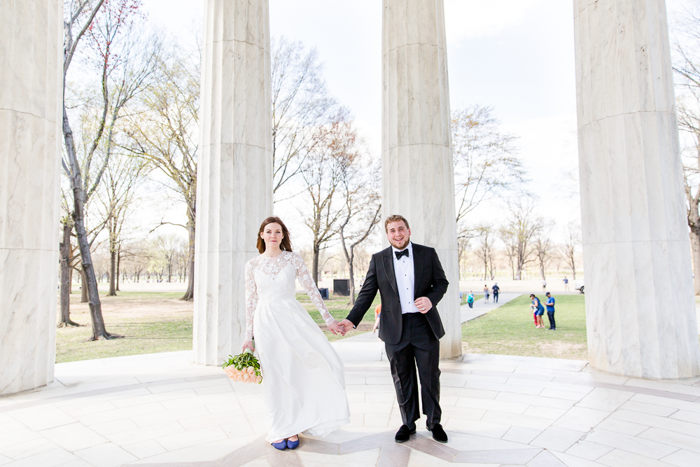 Wedding couple posing in the DC War Memorial on their spring wedding day | Best Outdoor Wedding Venues in Washington, DC
