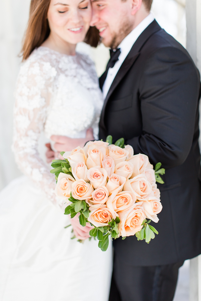 Happy photo of the wedding couple, with flowers by Allan Woods Flowers | Washington DC Wedding Florist