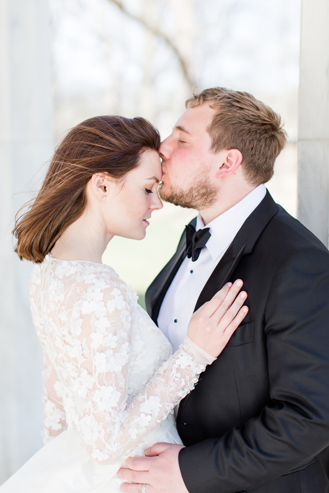 Groom gives the bride a kiss on the forehead | Washington, DC Wedding Photographer