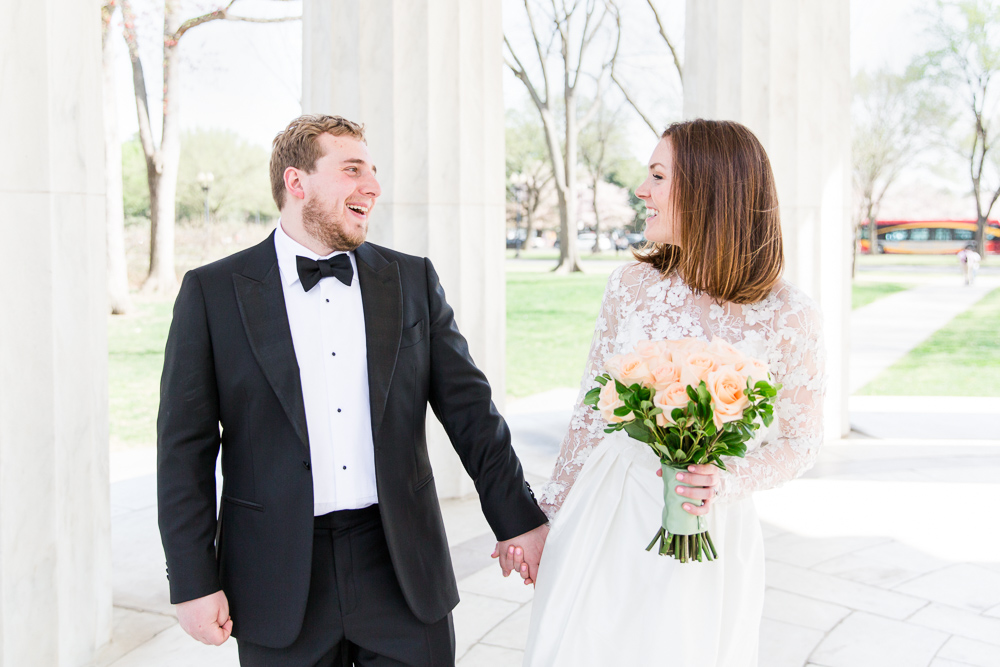 Bride and groom candid wedding photo at the DC War Memorial | Megan Rei Photography
