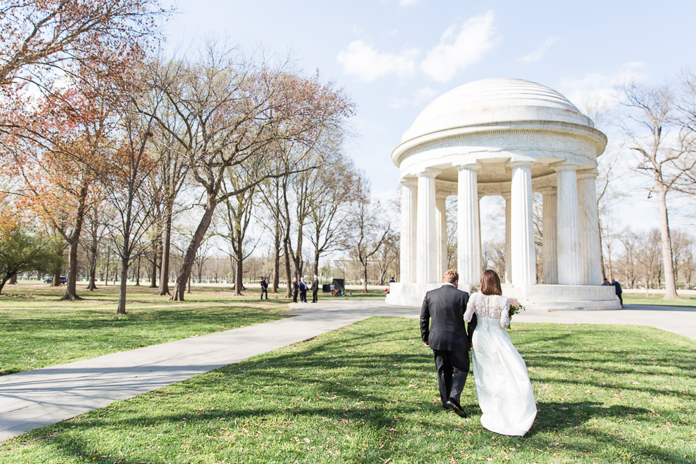 Bride and groom walking up to the DC War Memorial where they had their intimate wedding ceremony