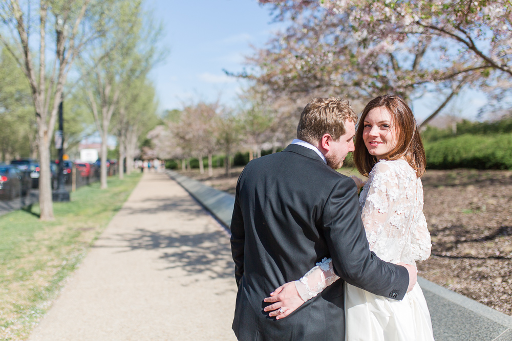A sweet wedding photo with the cherry blossom trees in Washington, DC | Cherry blossom wedding pictures