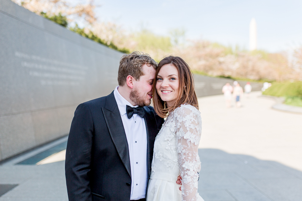 Wedding photo near the cherry blossoms with the Washington Monument in the background | Washington DC Wedding Photography
