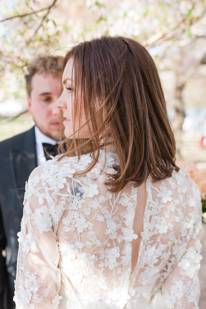 Photo of the bride's wedding dress near the cherry blossoms | Rue de Seine dress from Lovely Bride, Rochester, NY bridal shop