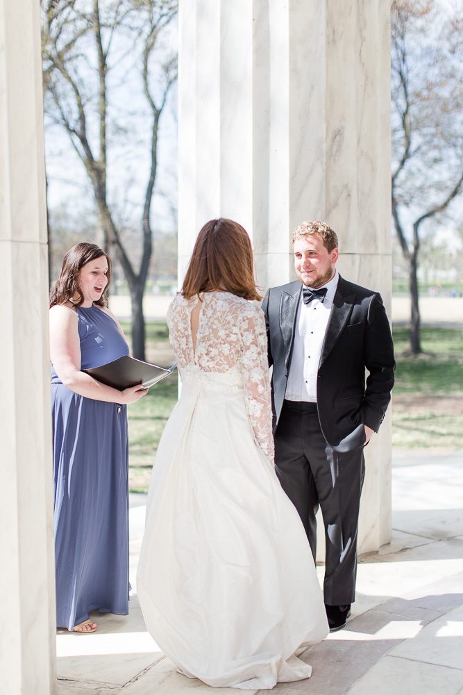 Groom looking at the bride during the wedding | Candid Wedding Photography at the DC War Memorial