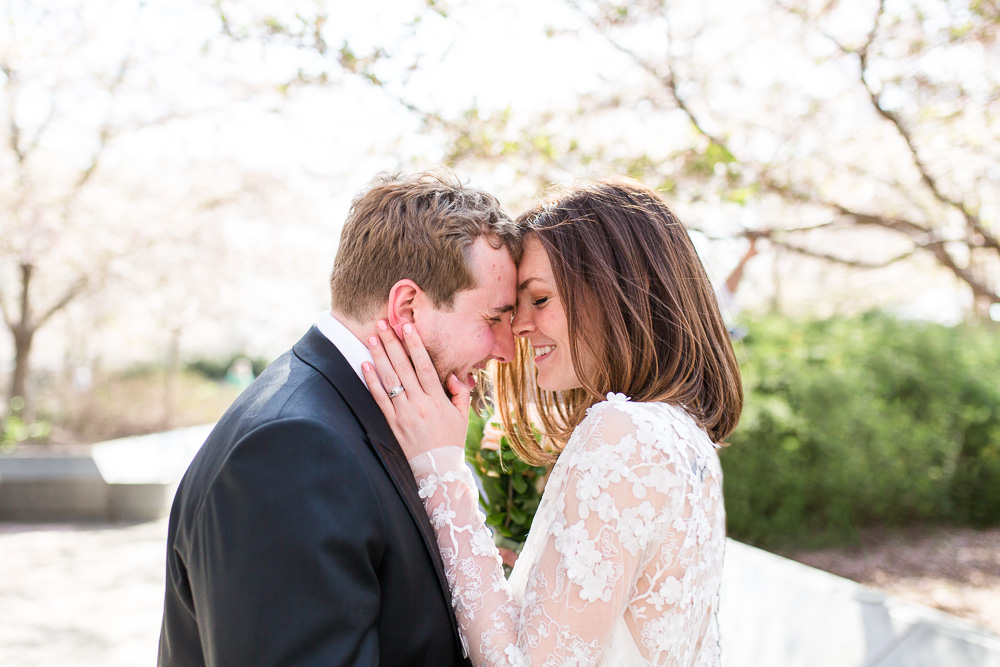 Wedding couple cuddles up together for their spring wedding photos in DC | Natural and candid wedding pictures in Washington DC