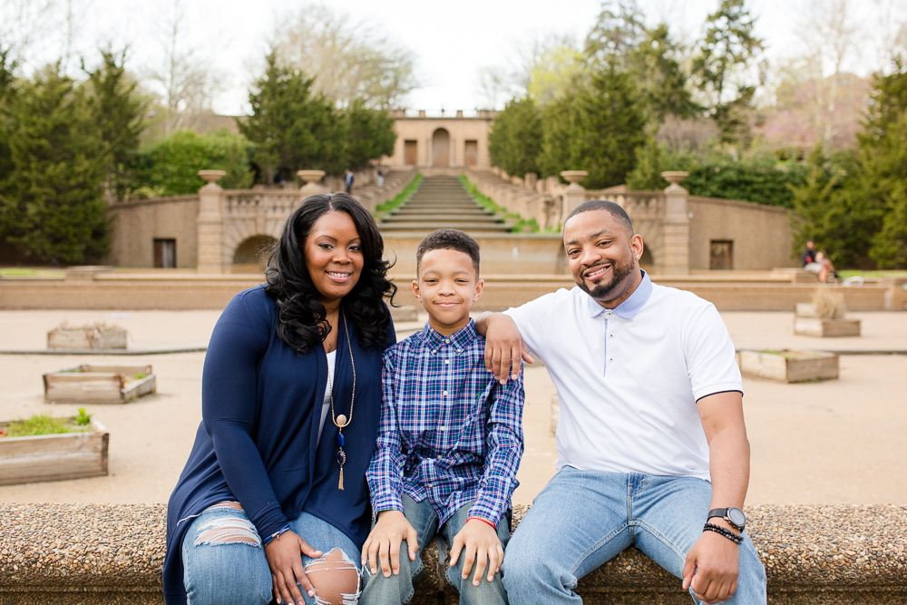 Smiling family picture in front of the steps and fountain at Meridian Hill Park | Candid DC Photographer